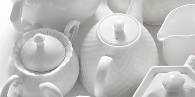 Порцелянові чайники, кавники і молочники